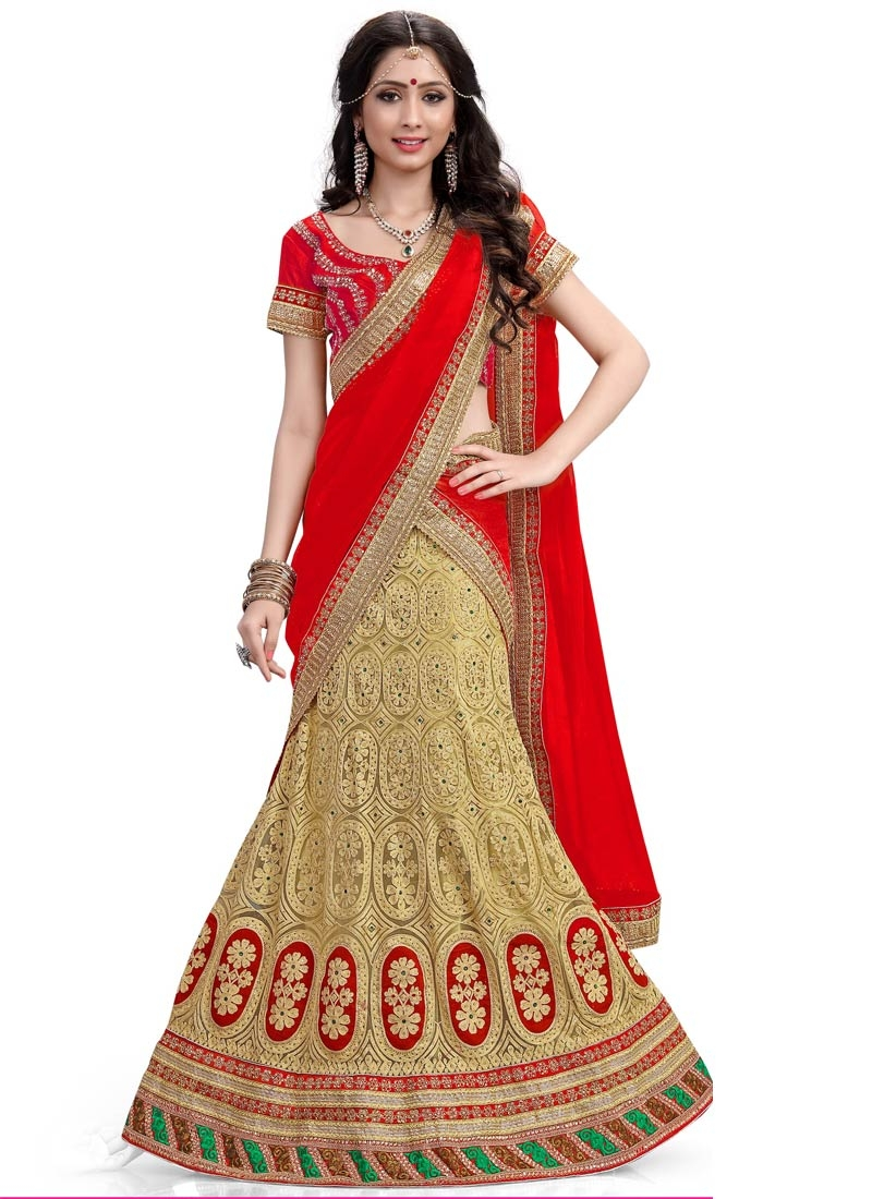 Trendy Stone Work Net Cream Color Wedding Lehenga Choli