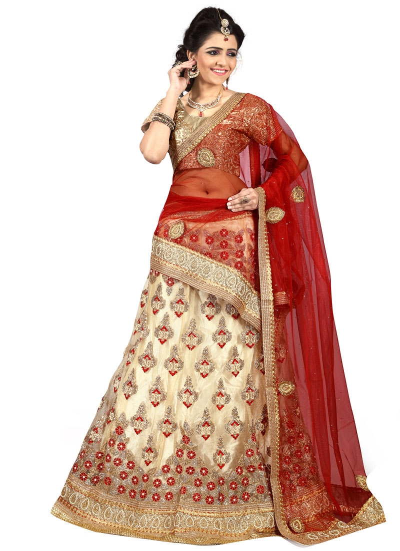 Vehemently Beads Work Cream Color Net Bridal Lehenga Choli
