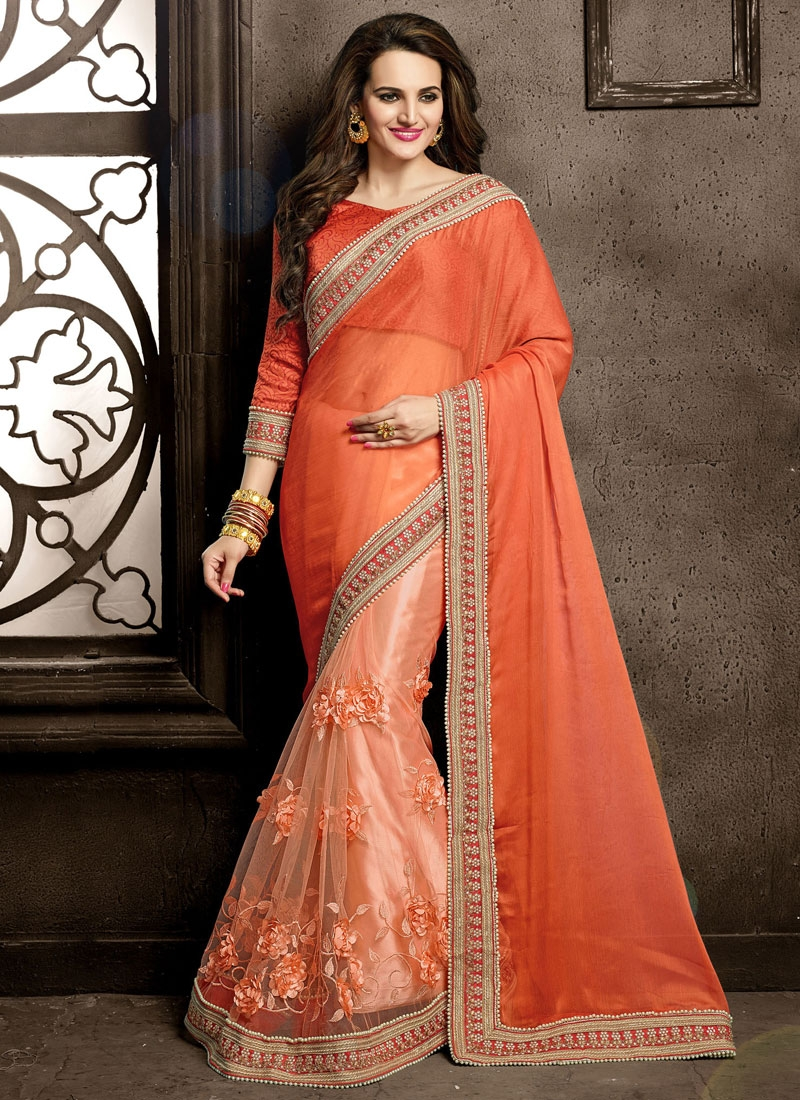 Vehemently Floral And Beads Work Net Wedding Saree