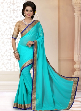 Vibrant Turquoise Color Lace Work Casual Saree
