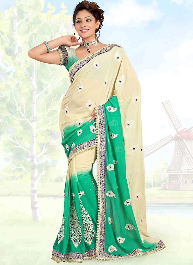 Vivacious Cream And Turquoise Color Saree