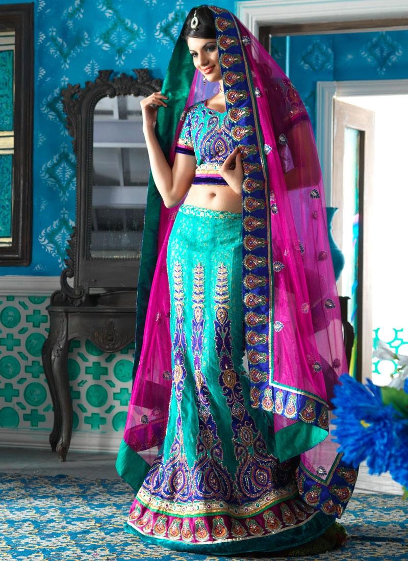 Vivacious Turquoise And Magenta Net Lehenga Choli