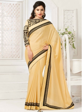 Voluptuous Cream Color Stone Work Designer Saree