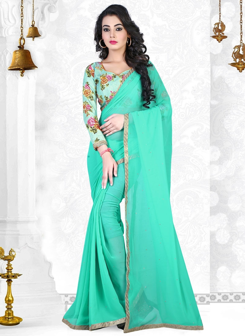 Voluptuous Stone Work Turquoise Color Casual Saree